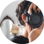Sara Barkat with a camera